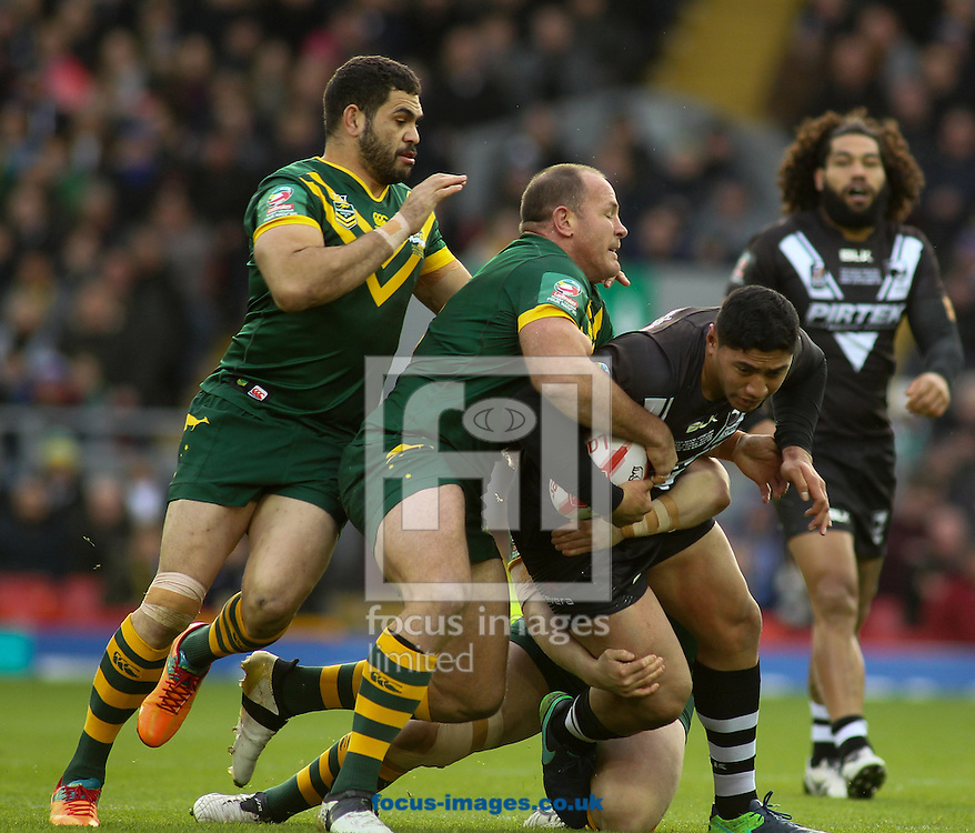 Greg Inglis and Matt Scott of Australia tackle Jason Taumalolo of New Zealand during the final of the 2016 Ladbrokes Four Nations at Anfield, Liverpool<br /> Picture by Stephen Gaunt/Focus Images Ltd +447904 833202<br /> 20/11/2016