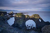 Gatklettur arch at sunset. Arnarstapi, Snæfellsnes Peninsula, West Iceland.