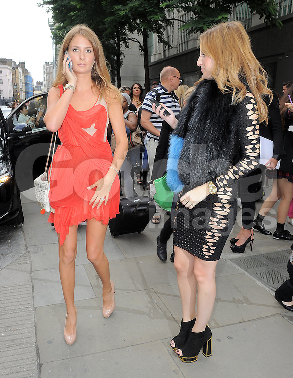 Mad In Chelsea star Millie Mackintosh and Rosie Fortescue attend the Julien Macdonald SS 2015 catwalk show during London Fashion Week Spring Summer 2015 in London, UK. 13/09/2014 <br />