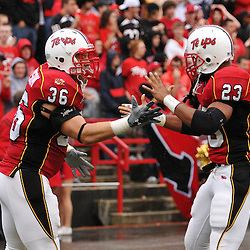 Sep 26, 2009; College Park, MD, USA; Maryland running back Taylor Watson (36) and Maryland running back Da'Rel Scott (23) high five in front of the student section before Rutgers' 34-13 victory over Maryland in NCAA college football at Byrd Stadium.