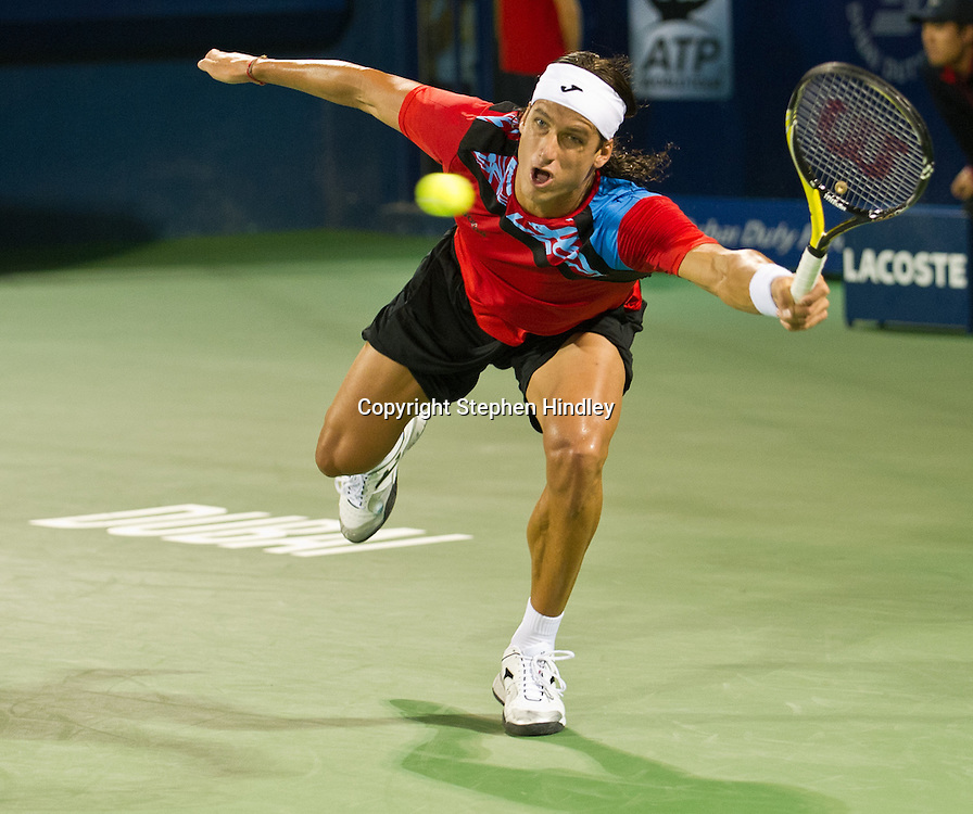 Feliciano Lopez of Spain stretches to make the return shot to Novak Djokovic of Serbia during the second round of the Dubai Duty Free Tennis Championships, held at the Dubai Tennis Stadium in Dubai, UAE, Wednesday, February 23rd, 2011. Photo by: Stephen Hindley/SPORTDXB