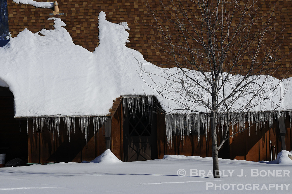 Snow and icicles on church roof