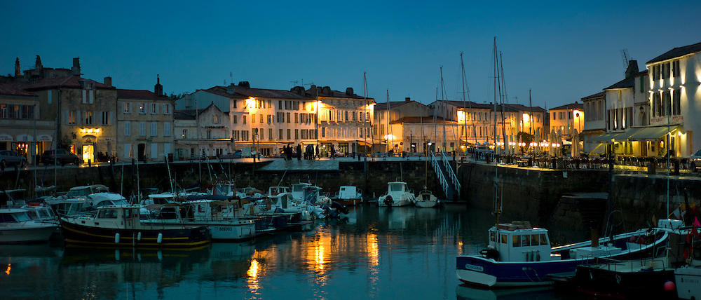 Harbour scene at dusk of Quai Job Foran, St Martin de Re on Ile de Re in France