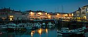 Harbour scene at dusk of Quai Job Foran, St Martin de Re on Ile de Re in France