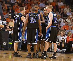 Duke guard Greg Paulus (3), guard DeMarcus Nelson (21), forward Kyle Singler (12), forward Lance Thomas (42), and guard/forward Gerald Henderson (15) huddle during the UVA. game.  The Virginia Cavaliers men's basketball team fell to the #6 Duke Blue Devils 86-70 at the University of Virginia's John Paul Jones Arena in Charlottesville, VA on March 5, 2008.