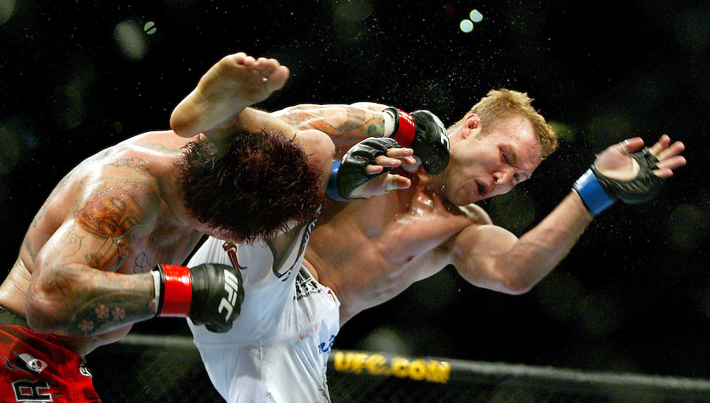 "UFC Middleweight ""Swing"" fighter Chris Leben gets in a powerful knockdown punch on the chin of Jake Rosholt who misses with a kick during their bout. The UFC 102 live from the Rose Garden featured many fights with Rosholt winning this one finally by submission."