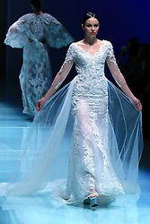 A model presents wedding dress designed by Wei Qiying during a fashion show of Jusere Wedding Dress Collection at China Fashion Week in Beijing, capital of China, March 30, 2016. EXPA Pictures © 2016, PhotoCredit: EXPA/ Photoshot/ Li Mingfang<br /> <br /> *****ATTENTION - for AUT, SLO, CRO, SRB, BIH, MAZ, SUI only*****
