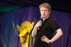 Image ©Licensed to i-Images Picture Agency. 18/07/2014. Henham Park , Suffolk, United Kingdom. Comedian JOSH WIDDICOMBE performs on the Comedy Stage. The Latitude Festival of music and arts . Picture by Joel Goodman / i-Images