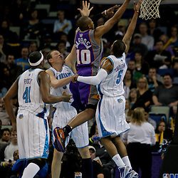 Nov 19, 2009; New Orleans, LA, USA;  Phoenix Suns guard Leandro Barbosa (10) shoots over three New Orleans Hornets defenders during the second quarter at the New Orleans Arena. Mandatory Credit: Derick E. Hingle-US PRESSWIRE