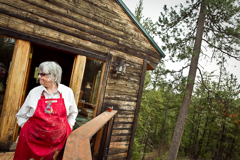 JEROME A. POLLOS/Press..Jaquith Travis stands outside the entrance of her hilltop home above Hauser Lake where she spends her days painting on either a canvas or her two computer monitors in her studio.
