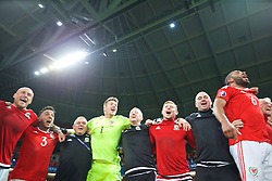 LILLE, FRANCE - Friday, July 1, 2016: Wales players celebrate in the team huddle following a 3-1 victory over Belgium and reaching the Semi-Final during the UEFA Euro 2016 Championship Quarter-Final match at the Stade Pierre Mauroy. Hal Robson-Kanu, David Cotterill, Neil Taylor, Kevin McCusker, goalkeeper Wayne Hennessey, Medical Officer Doctor Jon Houghton, Simon Church, performance psychologist Ian Mitchall, captain Ashley Williams. (Pic by David Rawcliffe/Propaganda)
