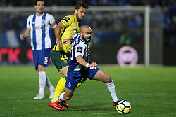 March 11, 2018 - Pacos Ferreira, Pacos Ferreira, Portugal - Porto's Portuguese midfielder Andre Andre (R) vies with Pacos Ferreira's forward Luiz Phellype (L) during the Premier League 2017/18 match between Pacos Ferreira and FC Porto, at Mata Real Stadium in Pacos de Ferreira on March 11, 2018. (Credit Image: © Dpi/NurPhoto via ZUMA Press)