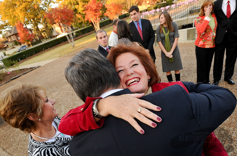 Photo by Gary Cosby Jr. Newly elected state representative Terri Collins hugs Steve Willard following her swearing in ceremony Sunday in Cotaco Park at the Morgan County Courthouse in Decatur.