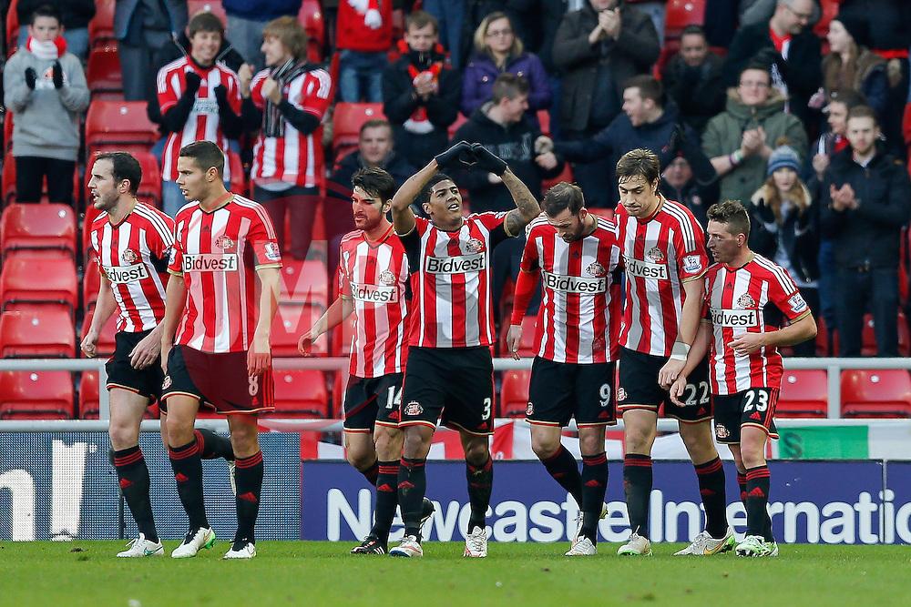 Patrick van Aanholt of Sunderland (#3) celebrates scoring a goal to make it 1-0 - Photo mandatory by-line: Rogan Thomson/JMP - 07966 386802 - 04/01/2015 - SPORT - FOOTBALL - Sunderland, England - Stadium of Light - Sunderland v Leeds United - FA Cup Third Round Proper.