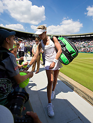 LONDON, ENGLAND - Wednesday, July 2, 2014: Eugenie Bouchard (CAN) signs autographs as she walks off Court No. 1 after winning during the Ladies' Singles Quarter-Final match on day nine of the Wimbledon Lawn Tennis Championships at the All England Lawn Tennis and Croquet Club. (Pic by David Rawcliffe/Propaganda)