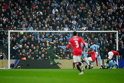 MANCHESTER, ENGLAND - Sunday, January 8, 2012: Manchester United's Wayne Rooney scores the first goal against Manchester City's goalkeeper Costel Pantilimon during the FA Cup 3rd Round match at the City of Manchester Stadium. (Pic by David Rawcliffe/Propaganda)