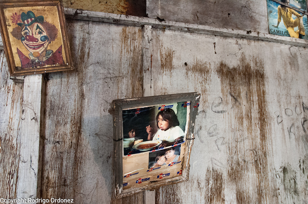 At the Jim&eacute;nez family's home, a photograph hanging on the wall shows the past of the building, which used to host the community-run soup kitchen.<br /> In a place ignored by politicians, the community group has taken charge of services that should be provided by the government. Each morning, four people collect the trash with horse carts. The group also organizes training programs, health counseling and micro-enterprise initiatives. Most notably, a community-run soup kitchen feeds children and destitute families. The community center they run also serves as a social meeting point.
