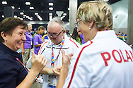 SO Poland athletes (R) Barbala Zapala and (L) Rafal Bednarczyk celebrate victory with their trainer coach at bocce competition during seventh day of the Special Olympics World Games Los Angeles 2015 on July 31, 2015 at South Hall of Convention Centre  in Los Angeles, USA.<br /> <br /> USA, Los Angeles, July 31, 2015<br /> <br /> Picture also available in RAW (NEF) or TIFF format on special request.<br /> <br /> For editorial use only. Any commercial or promotional use requires permission.<br /> <br /> Adam Nurkiewicz declares that he has no rights to the image of people at the photographs of his authorship.<br /> <br /> Mandatory credit:<br /> Photo by © Adam Nurkiewicz / Mediasport