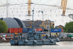 © Licensed to London News Pictures. 15/05/2014. Workers at Canary Wharf were surprised to see a flotilla of Germany Navy vessels appear outside their offices today. The port visit to London by the German Navy includes two mine sweepers (Siegburg and Auerbach), four remotely controlled drone ships, a refueling ship and more. The vessels will remain at West India Dock for the weekend. Credit : Rob Powell/LNP