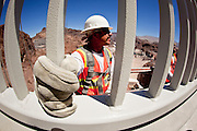 19 AUGUST 2010 --  HOOVER DAM, AZ: Gus Gomez, from Obayashi, works on the Hoover Dam By pass bridge.  Construction work is continuing on the Hoover Dam bypass bridge. The Colorado River Bridge is the central portion of the Hoover Dam Bypass Project. Construction on the nearly 2,000 foot long bridge began in late January 2005 and the completion of the entire Hoover Dam Bypass Project is expected in late 2010.  When completed, this signature bridge will span the Black Canyon (about 1,500 feet south of the Hoover Dam), connecting the Arizona and Nevada Approach highways nearly 900-feet above the Colorado River.   PHOTO BY JACK KURTZ