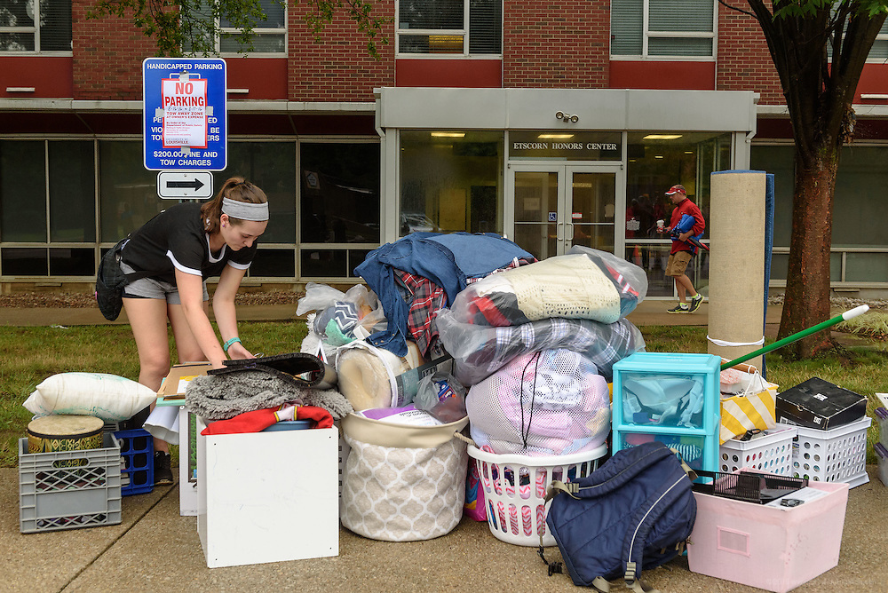 Freshman Mollie Sullivan, 18, piles her stuff on the sidewalk outside Threlkeld Hall as first-time students move in to Belknap Campus dormitories Wednesday during University of Louisville's Welcome Week. Aug. 17, 2016