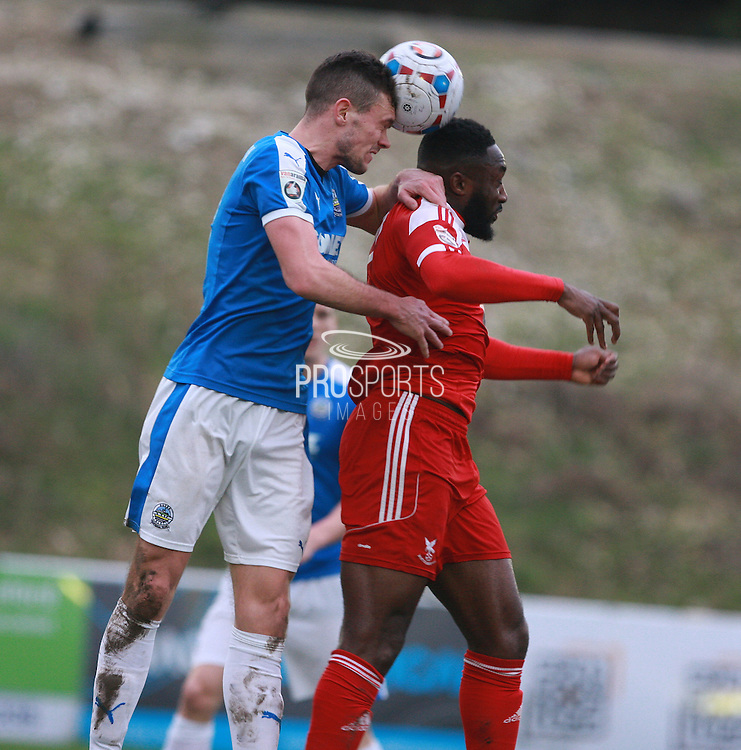 Dover midfielder Jack Parkinson competes for a high ball with Whitehawk defender Chris Sessegnon during the FA Trophy match between Whitehawk FC and Dover Athletic at the Enclosed Ground, Whitehawk, United Kingdom on 12 December 2015. Photo by Bennett Dean.
