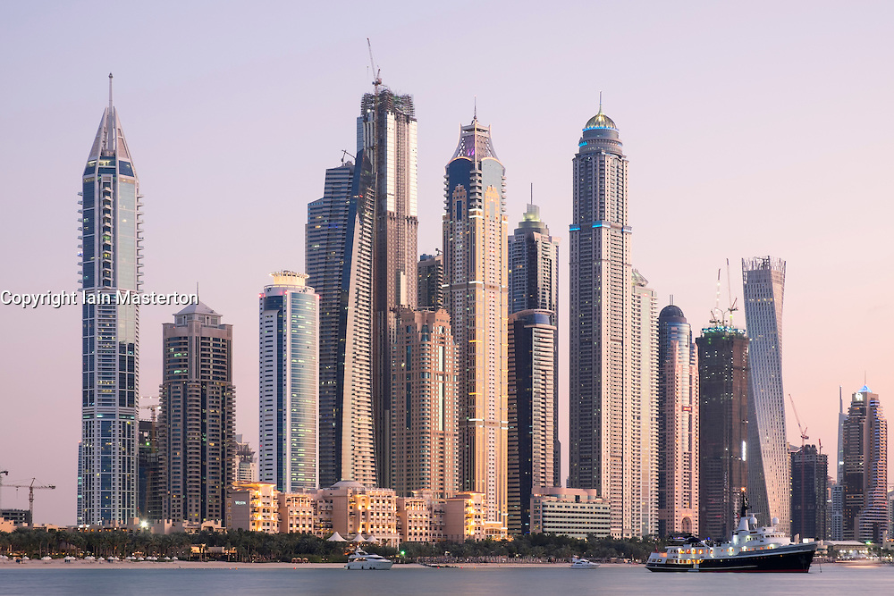 Skyline of skyscrapers at dusk  at Marina district in Dubai United Arab Emirates