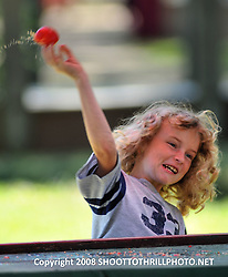 Athena Brumm hurls a high-speed tomato at Bristol's town loudmouth during a game of Vegetable Justice at the annual Faire held in Kenosha, WI.