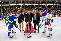 PENTICTON, CANADA - SEPTEMBER 16: Dean Clarke, Penticton Mayor Andrew Jakubeit, and former Vancouver Canucks' player, Stan Smyl prepare for the ceremonial puck drop with Cole Cassels #52 of Vancouver Canucks and Kyle Platzer #71 of the Edmonton Oilers on September 16, 2016 at the South Okanagan Event Centre in Penticton, British Columbia, Canada.  (Photo by Marissa Baecker/Shoot the Breeze)  *** Local Caption *** Stan Smyl; Andrew Jakubeit; Dean Clarke; Cole Cassels; Kyle Platzer;