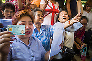 "01 FEBRUARY 2014 - BANGKOK, THAILAND: Thai women try to get into the election offices in Din Daeng to vote Sunday. The polls in Din Daeng never opened because anti-government protestors blocked access to the polls. Thais went to the polls in a ""snap election"" Sunday called in December after Prime Minister Yingluck Shinawatra dissolved the parliament in the face of large anti-government protests in Bangkok. The anti-government opposition, led by the People's Democratic Reform Committee (PDRC), called for a boycott of the election and threatened to disrupt voting. Many polling places in Bangkok were closed by protestors who blocked access to the polls or distribution of ballots. The result of the election are likely to be contested in the Thai Constitutional Court and may be invalidated because there won't be quorum in the Thai parliament.    PHOTO BY JACK KURTZ"
