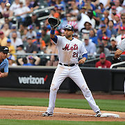 NEW YORK, NEW YORK - July 05: James Loney #28 of the New York Mets makes the out at first base of Giancarlo Stanton #27 of the Miami Marlins during the Miami Marlins Vs New York Mets regular season MLB game at Citi Field on July 04, 2016 in New York City. (Photo by Tim Clayton/Corbis via Getty Images)