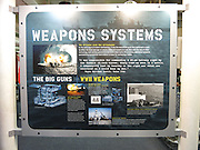 A placard shows the weapons systems of the USS Iowa at the time when she saw duty during World War II operations, now docked as a museum and tourist attraction in the San Pedro Harbor on November 30, 2013 in Los Angeles, California. ©Paul Anthony Spinelli