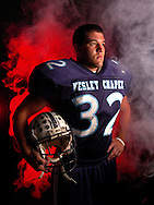 CAPTION: (photographers comment: I shoot a lot of sports action, so the 2005 Pasco Football tab was a different project for me that I enjoyed. A Fantastic Four them left me with the task of creating fire around the players without using live fire or computer generated effects. When combining unusual ingredients to make a portrait (in this case fog and colored lights) it's always rewarding to bring a concept that existed only in my head to life in a photo.) Port Richey: 07/22/2005) Running back Vince Chalecki (cq) of Wesley Chapel High School SUMMARY:Running back Vince Chalecki of Wesley Chapel