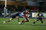 Rhys Patchell of the Scarlets  goes past Cam Dolan (l) and Tomos Williams of Cardiff Blues &reg; .  Guinness Pro12 rugby match, Cardiff Blues v Scarlets at the BT Cardiff Arms Park in Cardiff, South Wales on Friday 28th October 2016.<br /> pic by Andrew Orchard, Andrew Orchard sports photography.