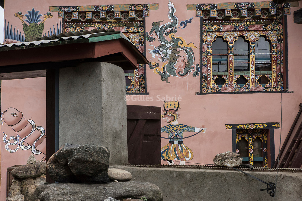 For a story by Steven Lee Myers, Bhutan<br /> Lobesa, Bhutan, August 2nd, 2017<br /> A traditional Bhutanese house decorated with elaborate paintings of mythical animals and that of a penis. Locals believe that the phallic symbols bring good luck and drives away evil spirits, Its origin can be found in the Bon religion that predated the advent of Tibetan Buddhism. Phallus representations are also linked to the XVIth century Lama Drukpa Kunley  popularly known as the &ldquo;Divine Madman&rdquo; for his unorthodox ways of teaching, and for his bizarre and shocking behaviours.<br /> Gilles Sabri&eacute; pour The New York Times