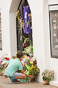 A young boy places flowers outside the Mother Emanuel African Methodist Episcopal Church following a memorial service for the Charleston Nine on the anniversary of the mass shooting June 18, 2016 in Charleston, South Carolina. Nine members of the church community were gunned down during bible study inside the church on June 17, 2015.