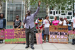 London, UK. 10 July, 2019. Matthew, a Movement for Justice campaigner, addresses a protest outside the Home Office against the government department's decision to try to block the return to the UK of PN, a Ugandan lesbian removed from the UK using the now unlawful fast track procedure in 2013 but who the High Court ordered on 24th June must be returned to the UK by the Home Office after the handling of her case was ruled to be 'procedurally unfair'.