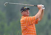 Gary Smithson from Thousand Oaks Golf Club tees off on the par three 17th hole of Boyne Mountains Alpine course during final round play at the 2009 Michigan PGA Tournament of Champions.