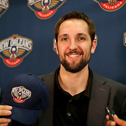 Jan 21, 2013; New Orleans, LA, USA; New Orleans Hornets power forward Ryan Anderson holds up a hat during a press conference to announce the rebranding of the team to the New Orleans Pelicans effective in the 2013-2014 NBA season at the New Orleans Arena. Mandatory Credit: Derick E. Hingle-USA TODAY Sports