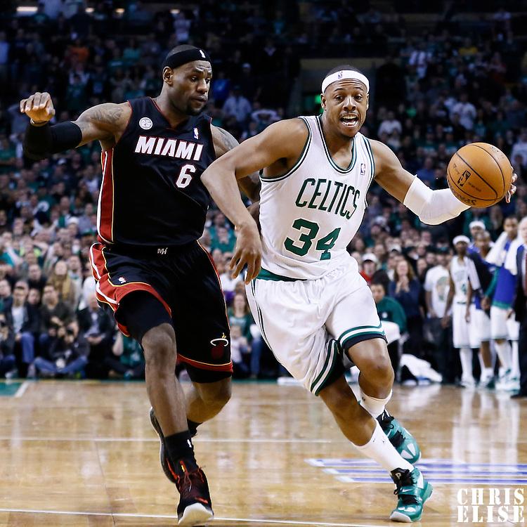 27 January 2013: Boston Celtics small forward Paul Pierce (34) drives past Miami Heat small forward LeBron James (6) during the Boston Celtics 100-98  2OT victory over the Miami Heat at the TD Garden, Boston, Massachusetts, USA.