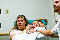 Corey Haas, 8, is comforted by his parents, Nancy and Ethan, before he enters surgery at the UPenn Medical Center in Philadelphia, PA on Thursday, September 25, 2008. Corey is sight-impaired and will undergo surgery injecting genetic material into his left eye in hopes of improving his vision.