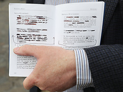 A man holds redacted copy of of the constitution at Dublin Castle as Ireland has voted to repeal the Eighth Amendment to the Constitution which prohibits abortions unless a mother's life is in danger.
