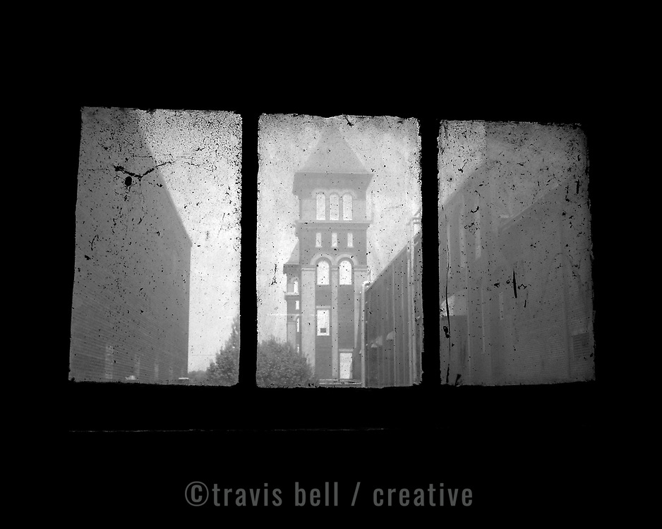 The towers in Lancaster, S.C. are only a memory now of what was once heralded as the world's largest cotton mill. The Springs Industries structure lifted the southern town on its shoulders, carrying it through America's depression and world wars, but fell in the shadow of free trade. ©Travis Bell Photography.