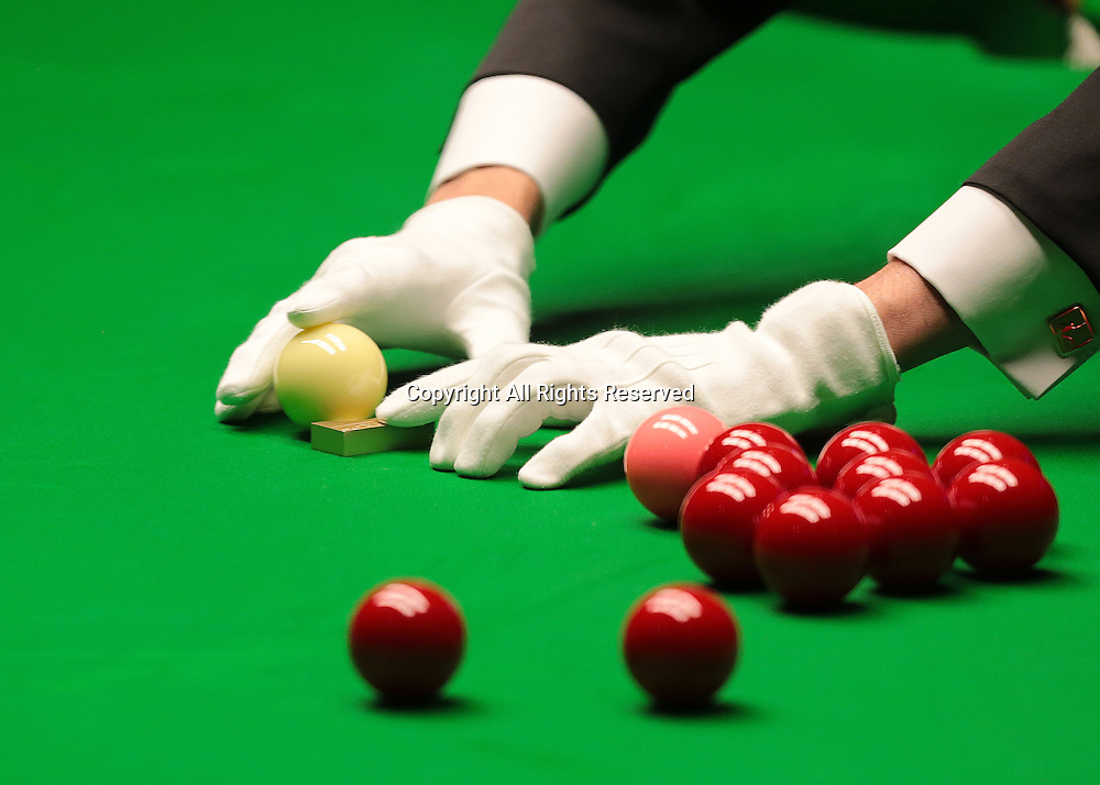 30.04.2016. The Crucible, Sheffield, England. World Snooker Championship. Semi Final, Ding Junhui versus Alan McManus.  The cue ball is cleaned