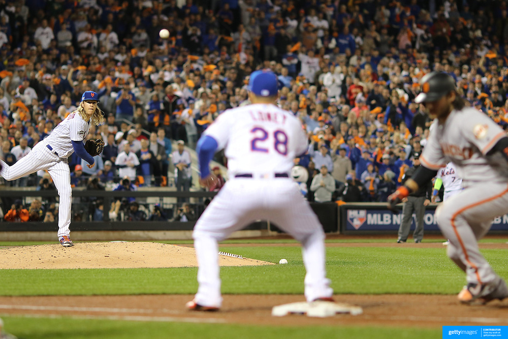 NEW YORK, NEW YORK - October 5: Pitcher Noah Syndergaard #34 of the New York Mets throwing over to James Loney #28 of the New York Mets at first base to hold the runner from stealing during the San Francisco Giants Vs New York Mets National League Wild Card game at Citi Field on October 5, 2016 in New York City. (Photo by Tim Clayton/Corbis via Getty Images)