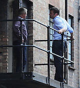 28.JULY.2009 - LONDON<br /> <br /> X-FACTOR JUDGE LOUIS WALSH TAKES A BREAK FROM FILMING THE X-FACTOR BOOTCAMP AT HAMMERSMITH APOLLO ON THE BALCONY AND WAS JOINED BY PRESENTER  DERMOT O'LEARY.<br /> <br /> BYLINE: EDBIMAGEARCHIVE.COM<br /> <br /> *THIS IMAGE IS STRICTLY FOR UK NEWSPAPERS AND MAGAZINES ONLY*<br /> *FOR WORLD WIDE SALES AND WEB USE PLEASE CONTACT EDBIMAGEARCHIVE - 0208 954 5968*