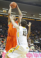 November 29, 2011: Clemson Tigers forward Milton Jennings (24) looks to pass over Iowa Hawkeyes forward Zach McCabe (15) during the first half of the NCAA basketball game between the Clemson Tigers and the Iowa Hawkeyes at Carver-Hawkeye Arena in Iowa City, Iowa on Tuesday, November 29, 2011. Clemson defeated Iowa 71-55 in the Big Ten-ACC Challenge game.