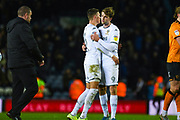 Leeds United defender Ben White (5) and Leeds United forward Patrick Bamford (9) react after winning 2-0 during the EFL Sky Bet Championship match between Leeds United and Hull City at Elland Road, Leeds, England on 10 December 2019.