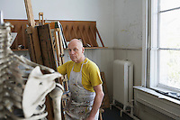 Artist drawing skeleton in studio