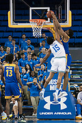 UCLA Bruins guard Armani Dodson (15) fouls San Jose State Spartans forward Christian Anigwe (11) on a dunk attempt during an NCAA college basketball game, Sunday, Dec. 1, 2019, in Los Angeles. UCLA defeated San Jose State 93-64. (Jon Endow/Image of Sport)